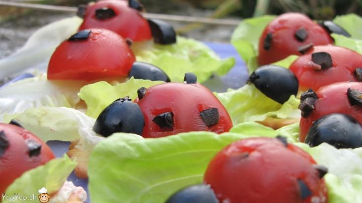 détail amuse bouche coccinelle tomate et olive